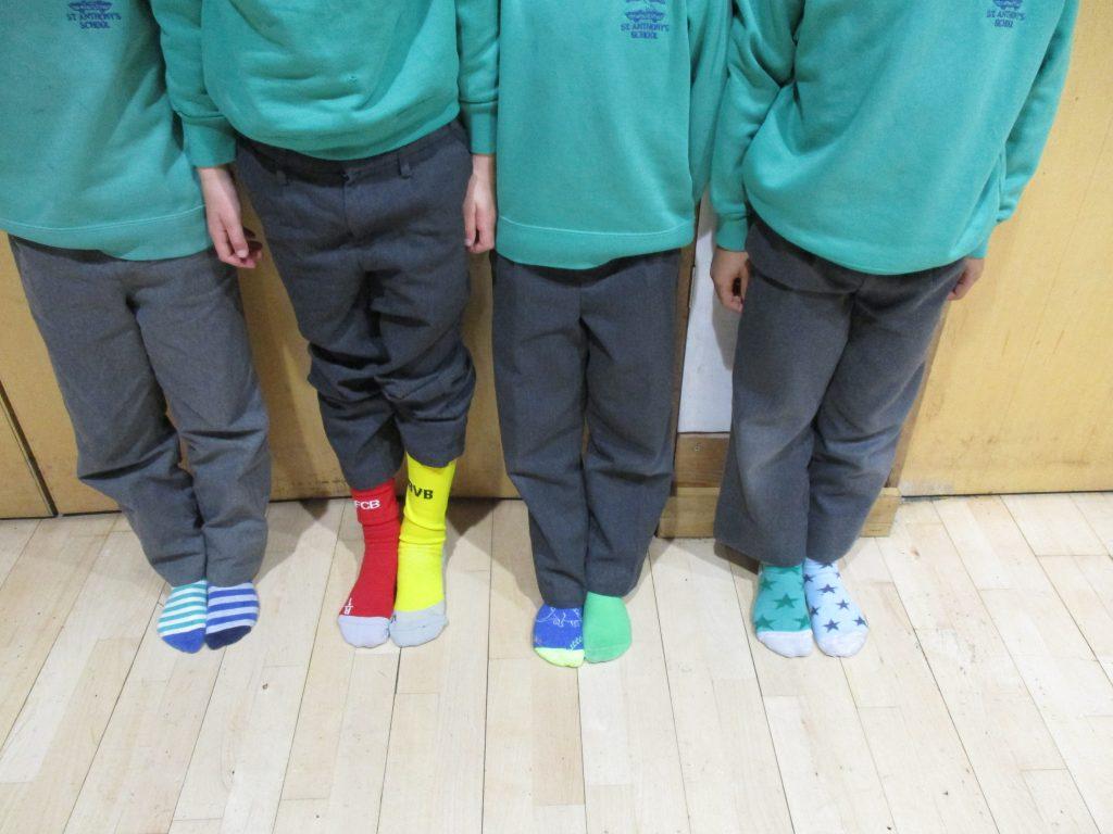 children wearing multicoloured socks