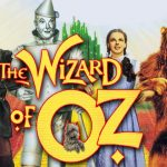 An image of the poster for the film The Wizard of Oz, featuring The Scarecrow, the Tin Man, Dorothy and The Lion